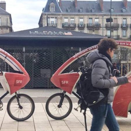 Des vélos taxis SFR à Grenoble - Keemia Communication OOH - Agence conseil et opérationnelle, Hors média & Solutions OOH