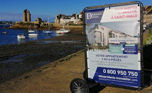 Opération de street marketing et d'affichage mobile pour Edouard Denis avec Keemia Nantes agence de marketing locale en région Atlantique